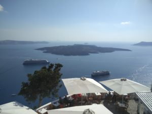 View from Fira with the volcanic island of Nea Kameni at the centre.