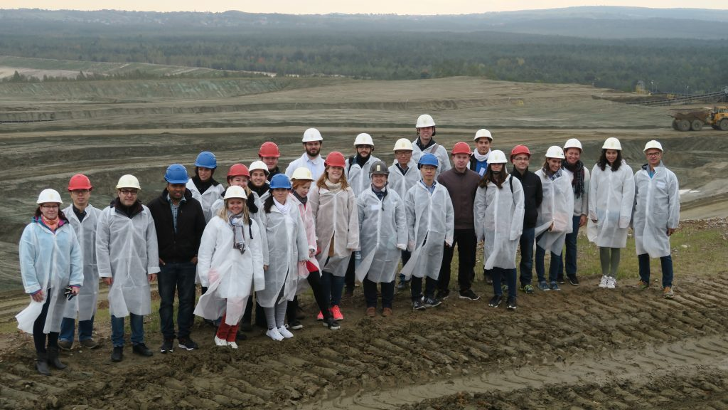 Young researchers standing on the residues of Zn production process of ZGH Boleslaw